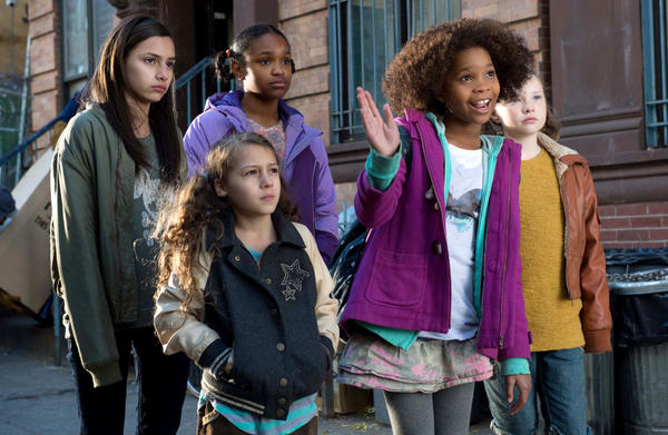 Quvenzhane Wallis (second from right) stars in an updated version of <em>Annie</em>, produced by Jay Z.