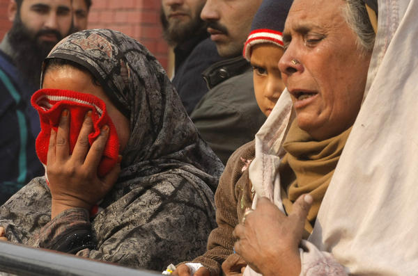 Relatives of injured students react as they arrive at a hospital dealing with the victims of the attack by Taliban gunmen on the school in Peshawar.