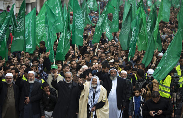 The Islamist group Hamas, shown here in a rally in the Gaza Strip on Dec. 12, is the strongest faction in the Gaza Strip. The Islamic State, or ISIS, is not believed to be in the territory, though fliers purporting to be from the group have circulated in Gaza. They are widely believed to be fake, but both Israel and Hamas have tried to use them to their advantage.