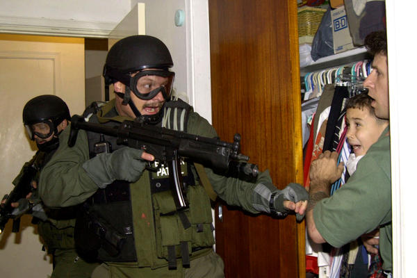 On April 22, 2000, government officials seized Elian Gonzalez, who is seen being held in a closet by Donato Dalrymple (right), one of the two men who rescued the Cuban boy from the ocean after his mother died trying to come to the U.S. Elian's U.S.-based relatives fought to keep him here, but the U.S. finally returned him to Cuba, where his father lived.