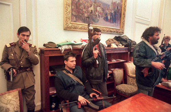Soldiers and armed civilians occupy the office of ousted Romanian leader Nicolae Ceausescu in the capital Bucharest on Dec. 26, 1989, the day after he was executed.