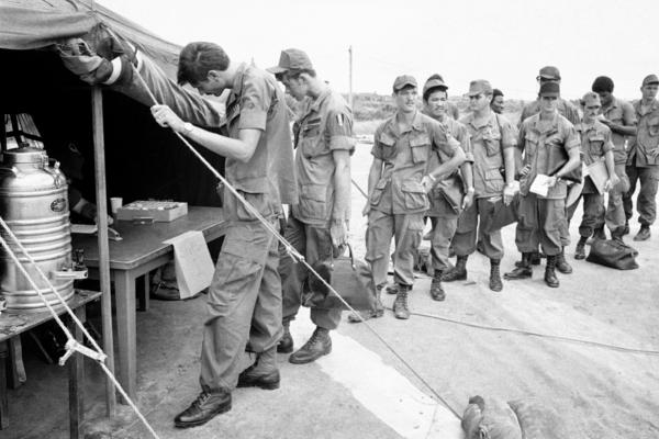 U.S. soldiers at Long Binh base in South Vietnam line up to give urine samples at a heroin detection center before departing for the United States. About 20 percent of soldiers said they were addicts, but most didn't continue drug use back home.
