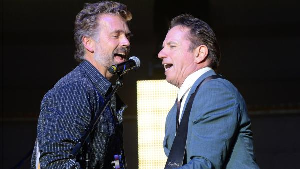 John Schneider (left) and Tom Wopat, who met as costars on <em>The Dukes of Hazzard</em>, say they bonded right away over a shared taste in music.
