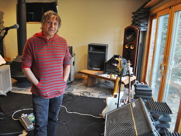 The Waitresses' founder and songwriter, Chris Butler, at his Akron house, with vintage Vox amplifier.