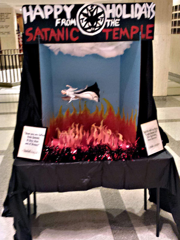 The Satanic Temple holiday display at the Florida Capitol on Monday — before it was vandalized.