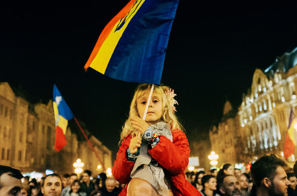 A young girl waves the Romanian flage at a recent anti-corruption rally in Timisoara, Romania.