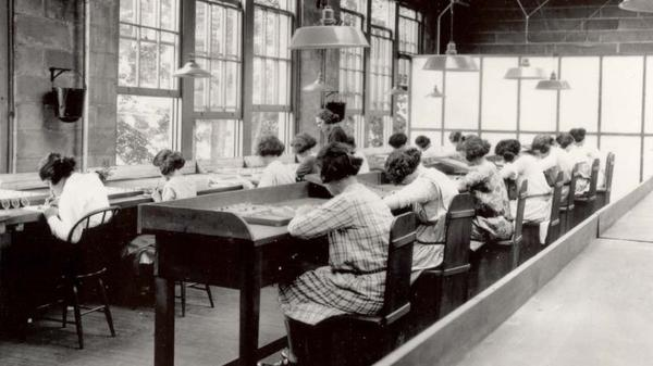 "Employees of the U.S. Radium Corp. paint numbers on the faces of wristwatches using dangerous radioactive paint. Dozens of women, known as ""radium girls,"" later died of radium poisoning. One of the last radium girls died this year at 107."