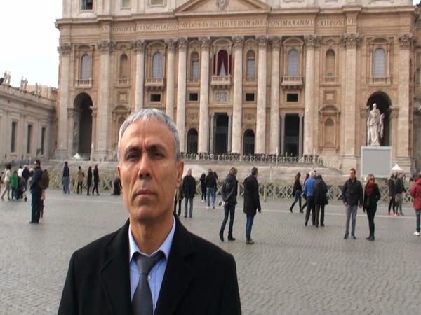 In this image taken from a video provided by Adnkronos International, Ali Agca stands in front of St. Peter's Basilica at the Vatican, on Saturday. Agca, who tried to assassinate Pope John Paul II in 1981, laid flowers at the late pontiff's tomb.