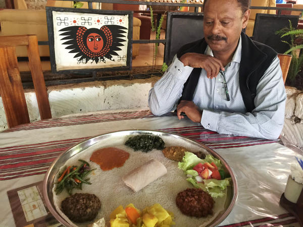 Abebe, the owner of Abyssinia, a popular Ethiopian eatery in Nairobi, Kenya, shows some of the foods permitted during the pre-Christmas fast. Orthodox Ethiopians typically eat just one vegan meal per day for 40 days before the Christmas feast on Jan. 7.