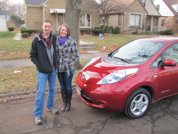 Chris and Ellie Eichman purchased a Nissan Leaf electric car in 2012 -- the first sold in Wisconsin. Chris says a fee for his Leaf is reasonable, but he's irked by the fee he'd pay for his second car, a Prius, given that he already pays a gas tax when he fills up. (Susan Bence/WUWM)