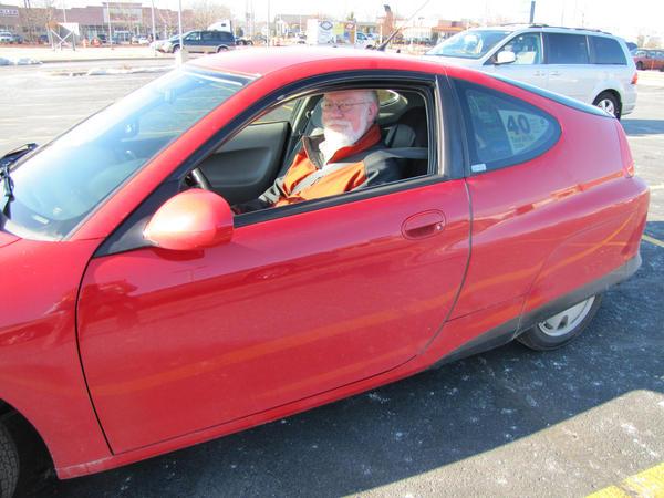 Bradlee Fons founded his hometown's 1500-member Milwaukee Hybrid Owner's Club. (Susan Bence/WUWM)