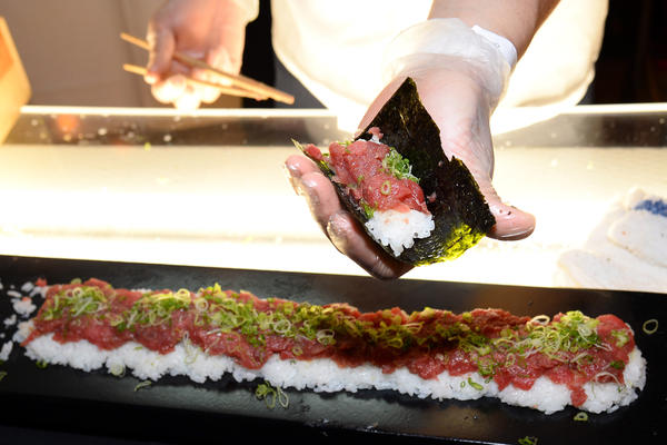 Hand-rolled bluefin tuna sushi is prepared with green onions at Vegas Uncork'd by Bon Appetit's Grand Tasting event in Las Vegas.