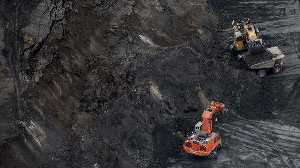 An excavator loads a truck with oil sands at the Suncor mine near the town of Fort McMurray in Alberta, Canada in 2009. Environmental groups that oppose oil sands mining have pointed to delayed and canceled projects as a sign of recent success.