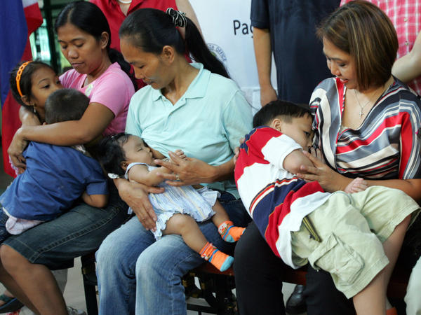 Mothers breast-feed their children of different ages during the Second Synchronized Breastfeeding Worldwide event near Manila, Philippines, in October 2008.