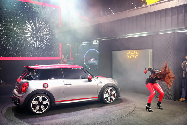 Singer Natalie La Rose helps to introduce the Mini John Cooper Works Concept car Tuesday at the North American International Auto Show in Detroit.