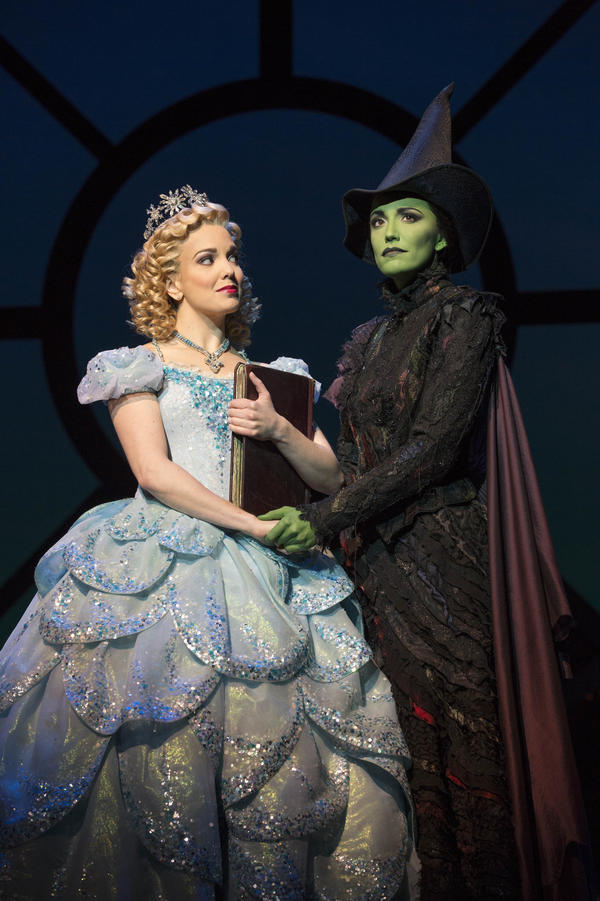 "Early reviews of <em>Wicked </em>""missed the boat,""<em> </em>says critic Jeremy Gerard. Above, Kara Lindsay (left) as Glinda and Caroline Bowman as Elphaba."