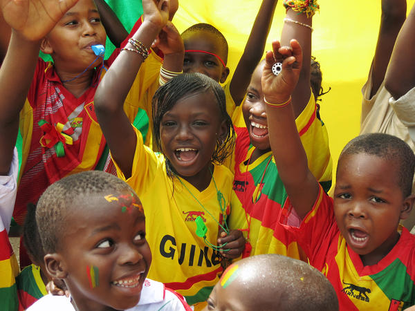Children showed off Guinea's national colors before their team's opening match with Ivory Coast in the Africa Cup of Nations.