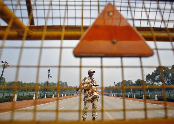 An Indian security personnel stands guard near India Gate ahead of the Republic Day Parade in New Delhi on Saturday. President Obama will attend the parade on Monday.