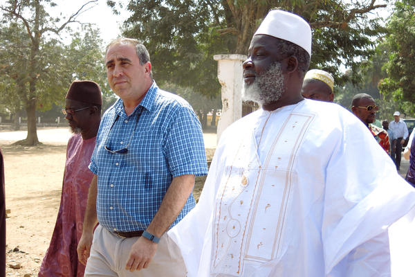The Grand Imam of Guinea, El Hadj Mamadou Saliou Camara, walks through the streets of Kindia with U.S. Ambassador, Alex Laskaris. Together they hope to end Ebola denial.
