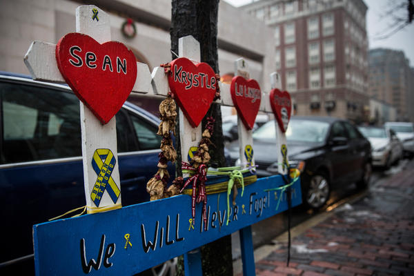 A memorial at the site of the first explosion in the Boston Marathon bombing. Defense attorneys say too many people in the potential jury pool have some kind of personal connection to the case.