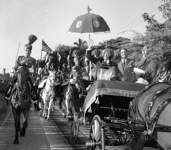 President Eisenhower and Pakistani President Mohammed Ayub Khan ride through the streets of Karachi in 1959. This wouldn't happen today.