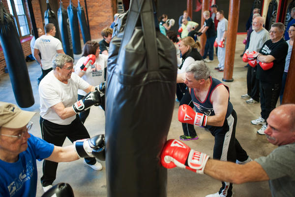 Participants in a boxing class designed specifically for people with Parkinson's disease at Fight 2 Fitness gym in Pawtucket, R.I.