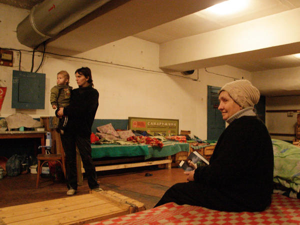 A woman sits inside a bomb shelter in Donetsk on Wednesday. Some local residents have lived in bomb shelters and basements for more than a month, looking for cover from artillery strikes.