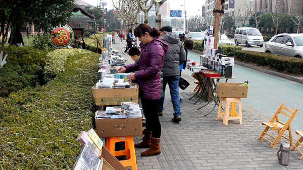 Some DVD vendors in Shanghai still sell on the street, but a government crackdown forced most out of business or into storefronts.