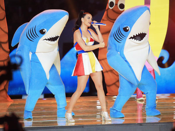 Katy Perry dances with a couple of sharks during the Super Bowl halftime show.