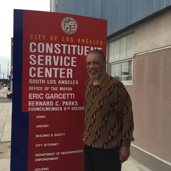 Council Member Bernard Parks stands in front of his office in South Los Angeles. He's concerned that raising the minimum wage to $15 an hour could create more unemployment.