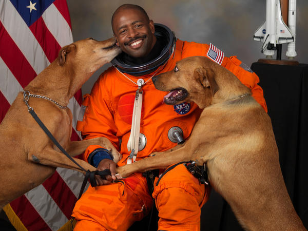 "Leland Melvin with his dogs, Jake and Scout. ""I snuck them into NASA to get this picture,"" Melvin says."