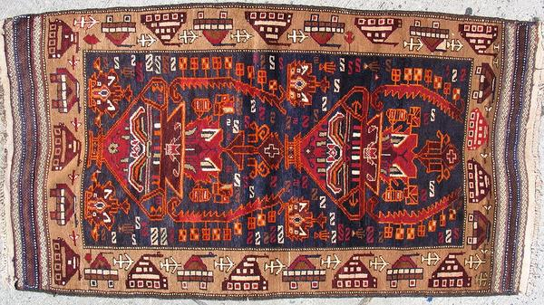 Some war rugs are more subtle in their depiction of war.