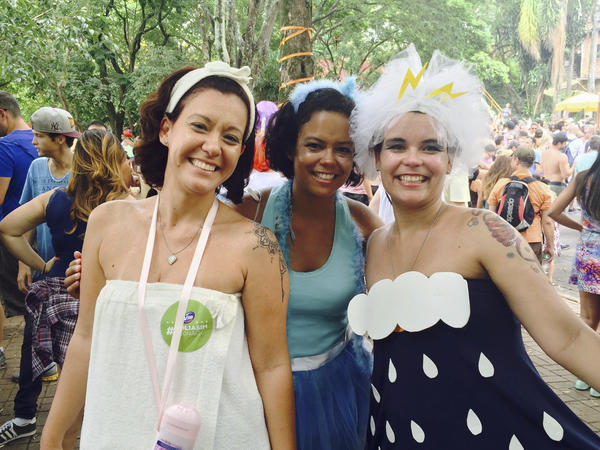 """Renata Cabral (left), Luciana Figueredo (right) and a friend dressed in water-themed costumes at a pre-Carnival block party in Sao Paulo. """"It's Carnival and we can't forget it's a reality the water is finishing and we have to do something,"""" said Cabral."""
