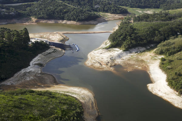 Brazil's Atibainha river dam is shown here in December 2014. It is part of Sao Paulo's system of dams, which supplies about half the water to the metropolitan region of 20 million people and is now at historic lows.