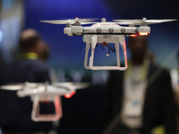 Drones fly at the International CES held last month in Las Vegas. In Oklahoma, a state senator has introduced a bill that would allow land-owners to shoot a drone down if it's above their property.