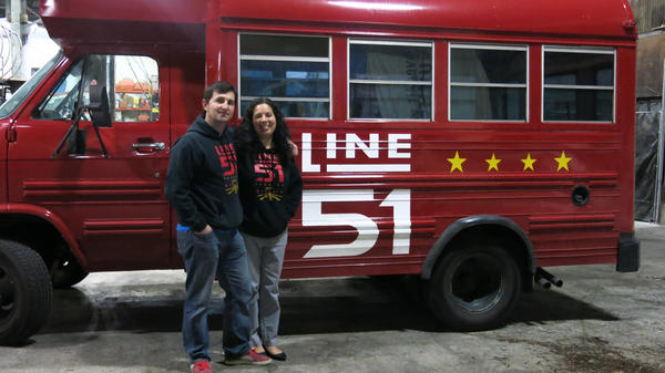 """Teachers P.T. and Leti Lovern remodeled a school bus to deliver beer. They named the bus """"Half Pint"""" for their brewing company, Line 51."""