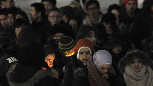 Several vigils were held last night in honor of three young Muslims who were killed in Chapel Hill, N.C., Tuesday. Here, attendees are seen at an event on the campus of the University of Michigan.