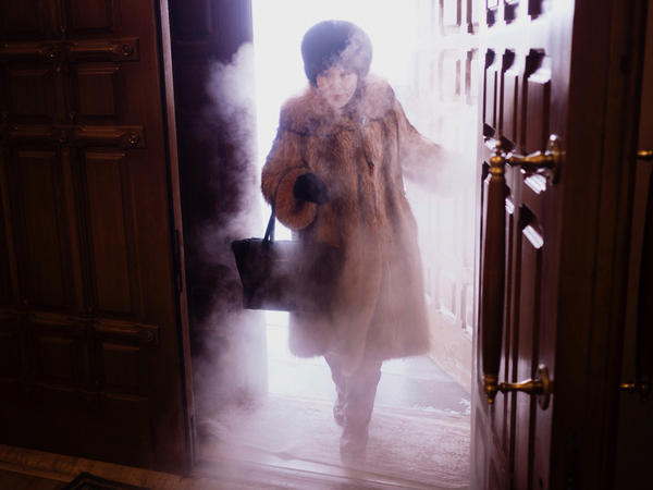 "A woman enters Preobrazhensky Cathedral in Yakutsk. ""You get this blast of freezing mist coming through the door,"" photographer Amos Chapple says. ""It was just spectacular."""