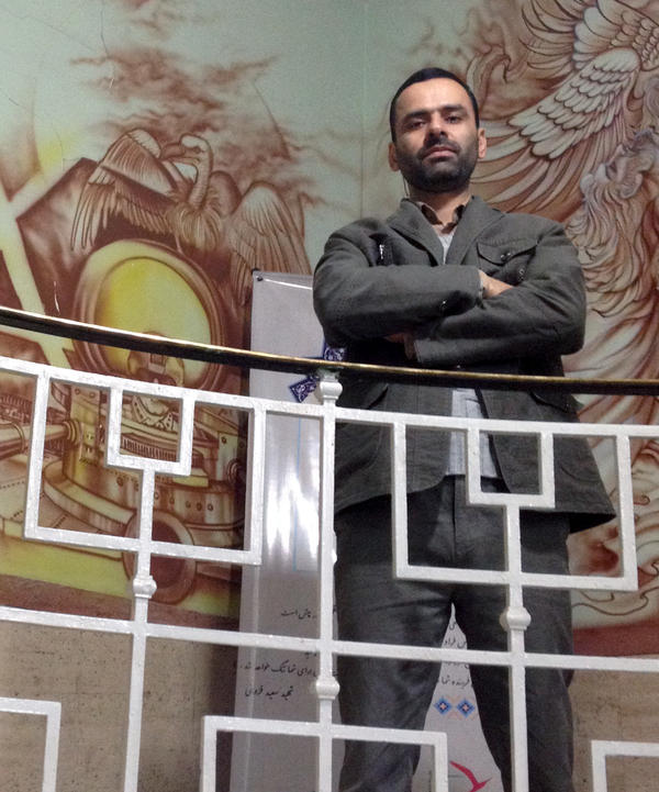 Mohammad Reza Shoghi, who handles public relations for the Basij, a revolutionary militia, poses in the former U.S. Embassy in Tehran, which is now a museum that's extremely critical of America. He doesn't believe Iran and the U.S. can have friendly relations.