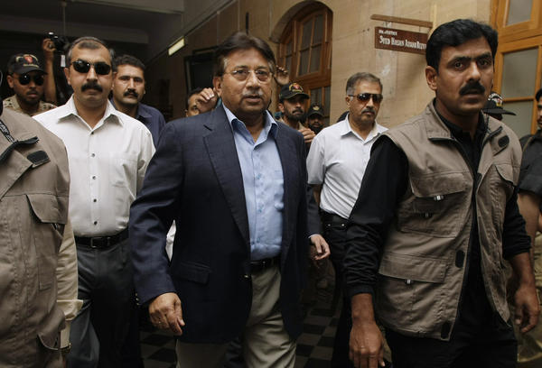 Surrounded by guards, Musharraf arrives at court in Karachi on March 29, 2013. His case is moving slowly through the legal system.