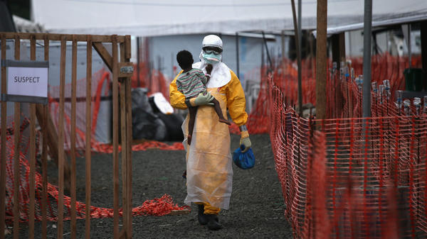 A health worker with Doctors Without Borders carries a child suspected of having Ebola at the treatment center in Paynesville, Liberia, last October. Ebola is especially deadly for young children and babies. About 4 in 5 infected died.