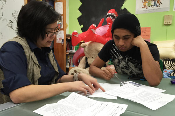 Jesus, an unauthorized immigrant from Mexico, gets help with tax documents from Mun Yin Yeow, a staff member at Atlas: DIY, a nonprofit in Brooklyn, N.Y. He asked NPR not to use his last name because he fears deportation if his application for deportation relief is not approved.