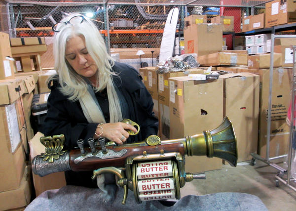 Trish Gallaher Glenn shows off the butter gun that was created for the new SpongeBob SquarePants movie.