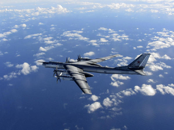 In this photo provided by Britain's Royal Air Force, taken Oct. 29, 2014, a Russian military long-range bomber aircraft photographed by an intercepting RAF Typhoon flies in international airspace.