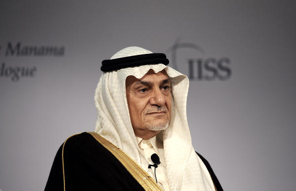Saudi Arabia's Prince Turki al-Faisal, shown in 2013 in Bahrain, says the 'pinpricks' against the Islamic State have not been effective. The former intelligence chief also says the campaign needs to be better coordinated.