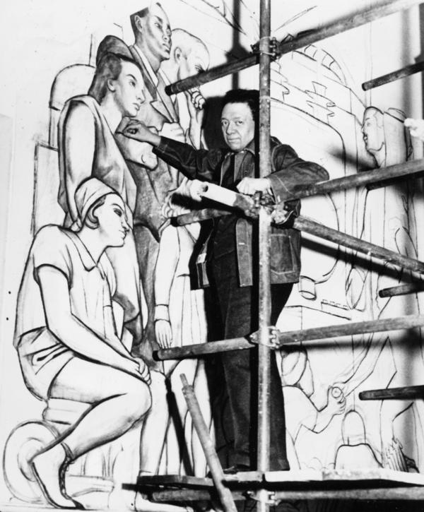 Diego Rivera, seen here in 1933, works on a panel of his mural in the lobby of Rockefeller Center.