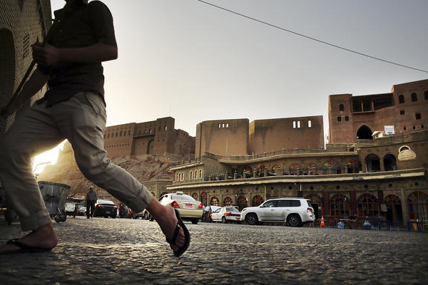 People walk near the Citadel in Erbil last June.