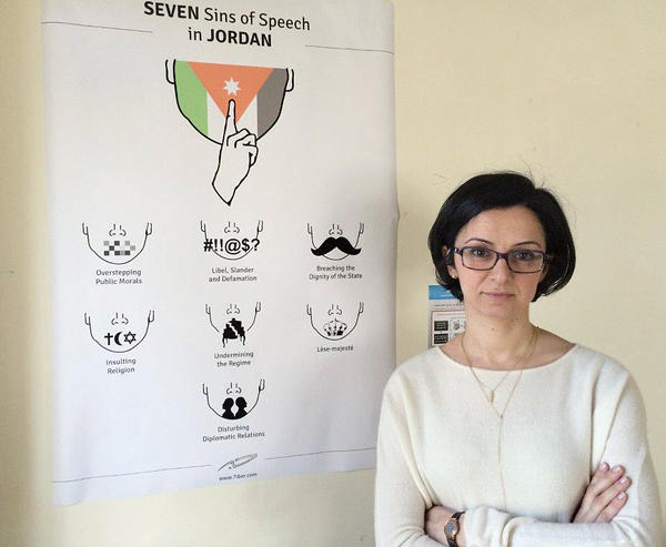 Lina Ejeilat helped found the Jordanian online magazine <em>7iber </em>(pronounced 'Hebber'). While the government encourages free expression in principle, many strict regulations remain, as noted by the satirical chart next to her.
