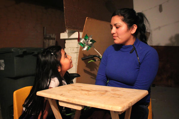 Farmworker Lorena Hernandez (right) with her daughter, Luzliliana.
