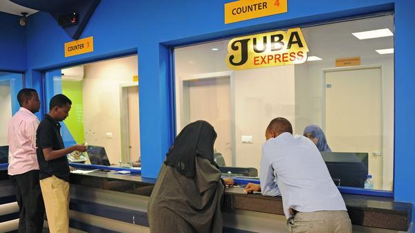 Customers wait to collect money at the Juba Express money transfer company in Mogadishu, Somalia, on Feb. 12.